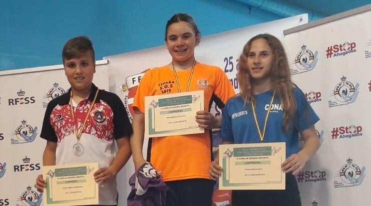 100 metros socorrista infantil: Diego Barbillo Rodríguez (C.D. Unión Esgueva SOSVA), Berta Arévalo Velasco (C.D. Oca SOS) y Silvia Chulia Coll (C.D. Natación Aldaia).